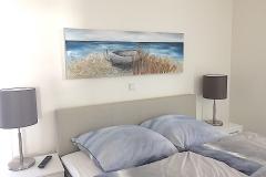 Schlafzimmer-mit-Ostsee-Bild-3D